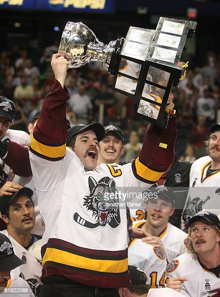 Darren Haydar of the Chicago Wolves holds up the Calder Cup trophy following a championship win over the WilkesBarre/Scranton Penguins during the...