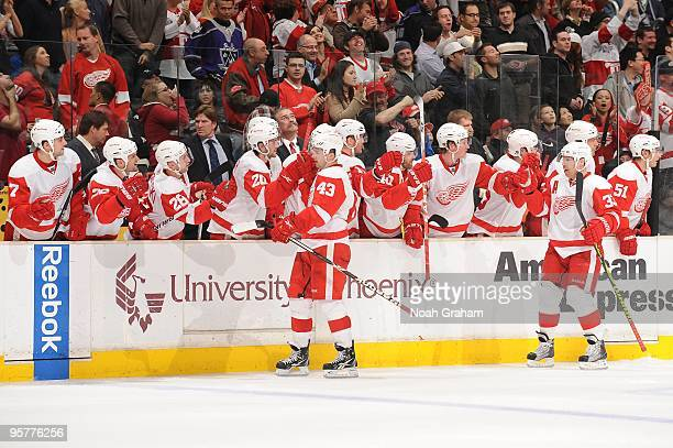 Darren Helm and Kris Draper of the Detroit Red Wings celebrate with the bench against the Los Angeles Kings on January 7 2010 at Staples Center in...