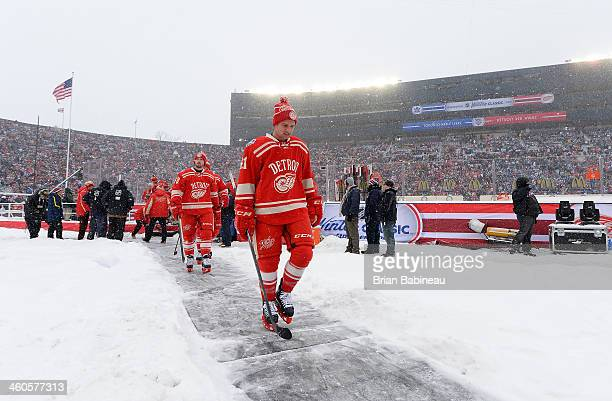 Darren Helm and Luke Glendening of the Detroit Red Wings walk back to the locker after warmup prior to the 2014 Bridgestone NHL Winter Classic on...