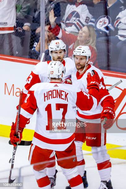 Darren Helm Luke Glendening and Filip Hronek of the Detroit Red Wings celebrate a second period goal against the Winnipeg Jets at the Bell MTS Place...