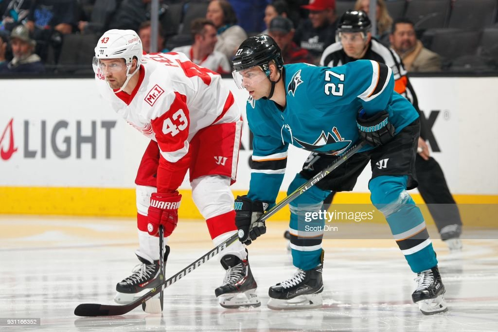 Darren Helm #43 of the Detroit Red Wings and Joonas Donskoi #27 of the San Jose Sharks get ready at SAP Center on March 12, 2018 in San Jose, California.