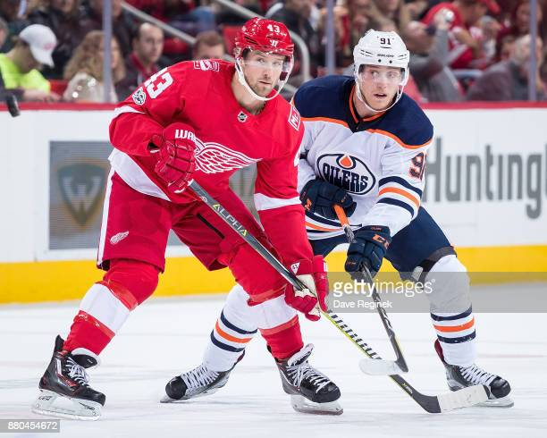 Darren Helm of the Detroit Red Wings battles for position with Drake Caggiula of the Edmonton Oilers during an NHL game at Little Caesars Arena on...