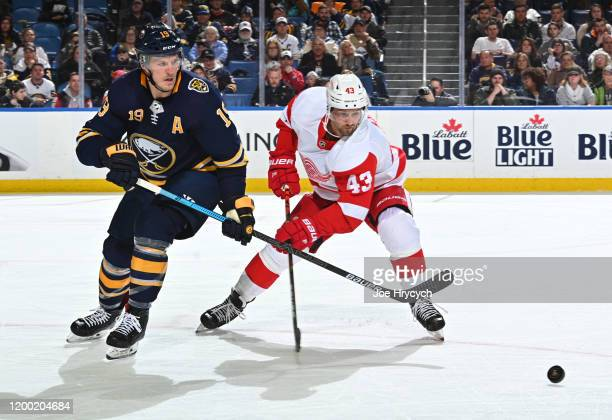 Darren Helm of the Detroit Red Wings battles for the puck against Jake McCabe of the Buffalo Sabres during an NHL game on February 11 2020 at KeyBank...
