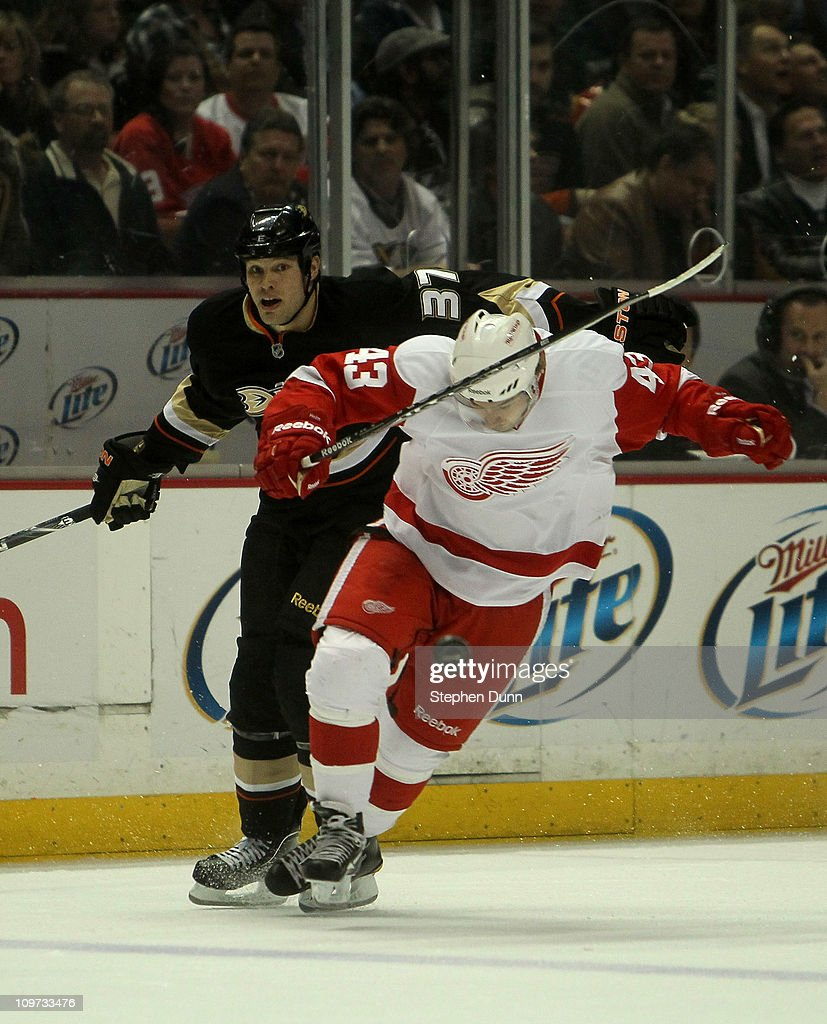 Darren Helm #43 of the Detroit Red Wings battles for the puck with Jarkko Ruutu #37 of the Anaheim Ducks on March 2, 2011 at the Honda Center in Anaheim, California. The Ducks won 2-1 in overtime.