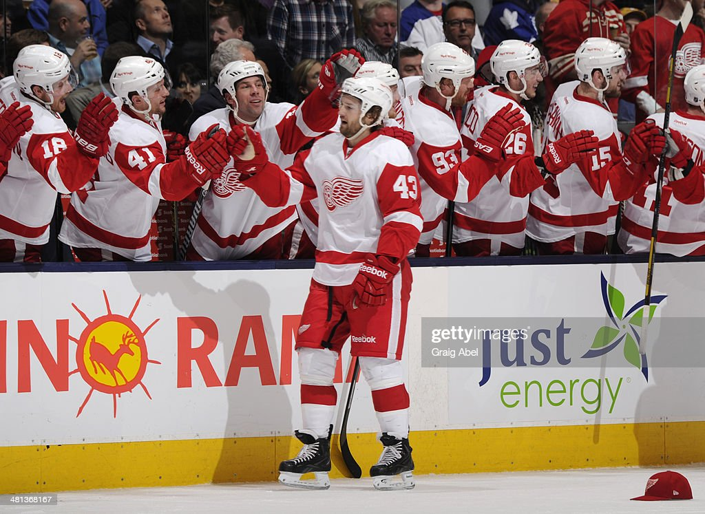 Darren Helm #43 of the Detroit Red Wings celebrates his third goal of the game with teammates during NHL game action against the Toronto Maple Leafs March 29, 2014 at the Air Canada Centre in Toronto, Ontario, Canada.