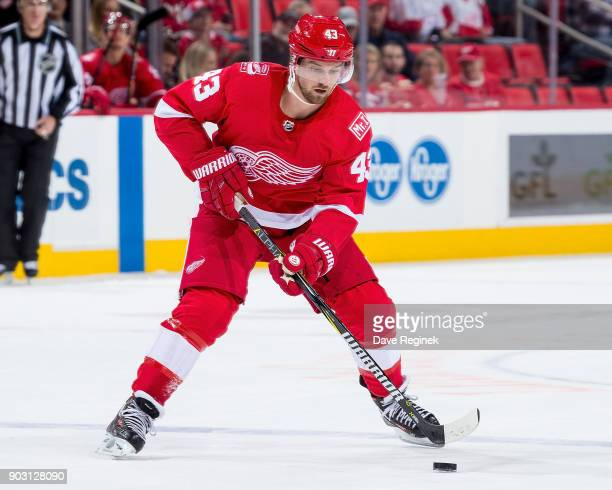 Darren Helm of the Detroit Red Wings controls the puck against the Florida Panthers during an NHL game at Little Caesars Arena on January 5 2017 in...