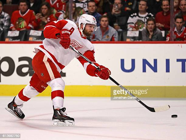 Darren Helm of the Detroit Red Wings firs a shot against the Chicago Blackhawks during a preseason game at the United Center on October 4 2016 in...