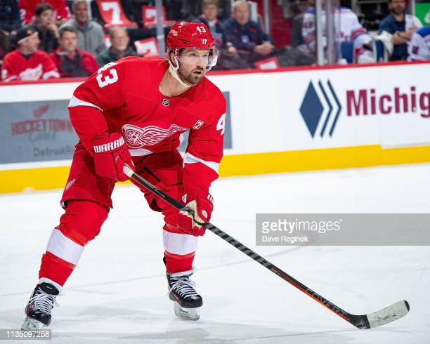 Darren Helm of the Detroit Red Wings follows the play against the New York Rangers during an NHL game at Little Caesars Arena on March 8 2019 in...