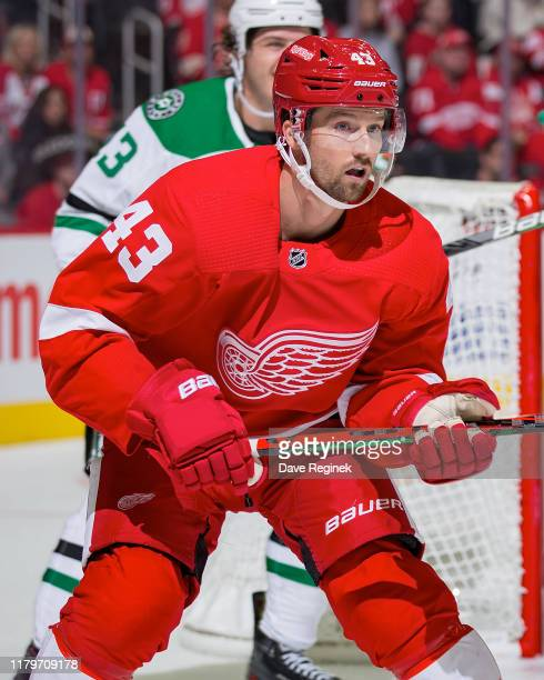 Darren Helm of the Detroit Red Wings follows the play against the Dallas Stars during an NHL home opening night game at Little Caesars Arena on...