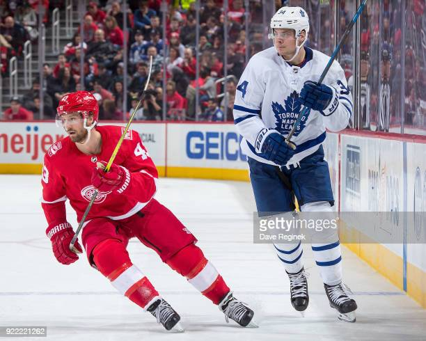Darren Helm of the Detroit Red Wings follows the play in front of Auston Matthews of the Toronto Maple Leafs during an NHL game at Little Caesars...