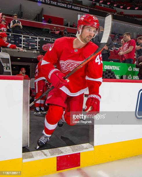 Darren Helm of the Detroit Red Wings hops onto the ice for in warm ups prior to an NHL game against the Ottawa Senators at Little Caesars Arena on...