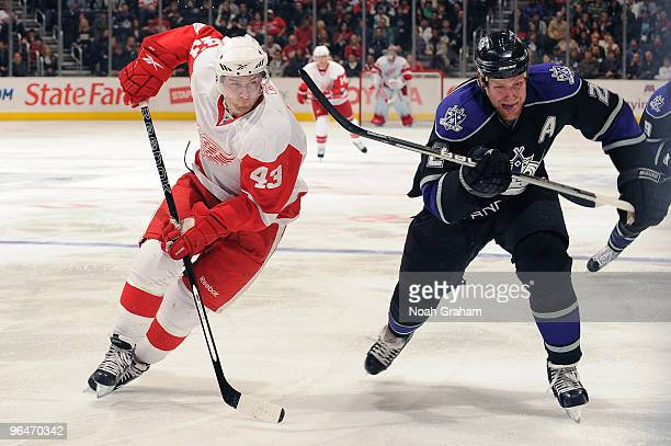 Darren Helm of the Detroit Red Wings looks for the puck against Matt Greene of the Los Angeles Kings on February 6 2010 at Staples Center in Los...