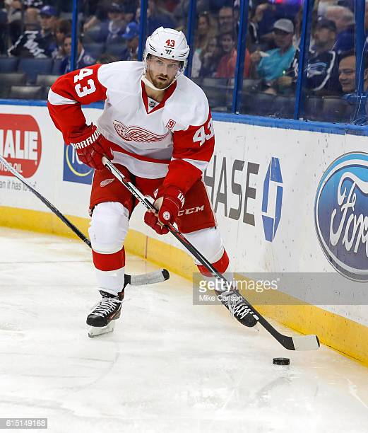 Darren Helm of the Detroit Red Wings looks to pass against Tampa Bay Lightning during a game at the Amalie Arena on October 13 2016 in Tampa Florida