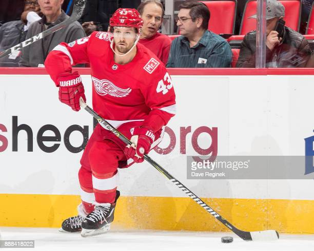 Darren Helm of the Detroit Red Wings looks to pass the puck against the Winnipeg Jets during an NHL game at Little Caesars Arena on December 5 2017...
