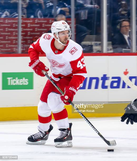 Darren Helm of the Detroit Red Wings plays the puck down the ice during first period action against the Winnipeg Jets at the Bell MTS Place on March...