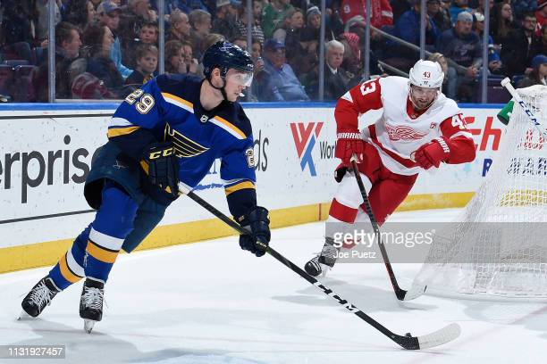 Darren Helm of the Detroit Red Wings pressures Vince Dunn of the St Louis Blues at Enterprise Center on March 21 2019 in St Louis Missouri