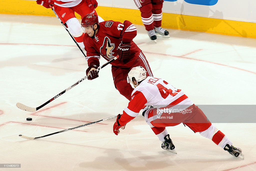 Darren Helm #43 of the Detroit Red Wings reaches to try to knock the puck off the stick of Radim Vrbata #17 of the Phoenix Coyotes on April 18, 2011 in Game Three of the Western Conference Quarterfinals during the 2011 NHL Stanley Cup Playoffs at Jobing.com Arena in Glendale, Arizona.