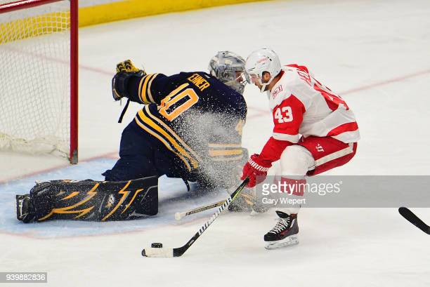 Darren Helm of the Detroit Red Wings scores a second period goal against Robin Lehner of the Buffalo Sabres during an NHL game on March 29 2018 at...
