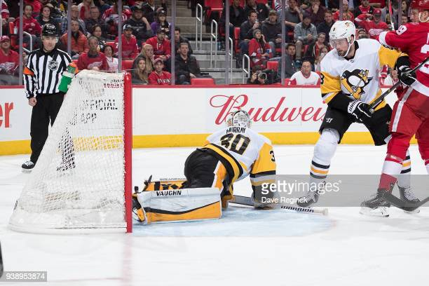 Darren Helm of the Detroit Red Wings scores a third period goal past Matt Murray of the Pittsburgh Penguins as Anthony Mantha of the Wings battles...