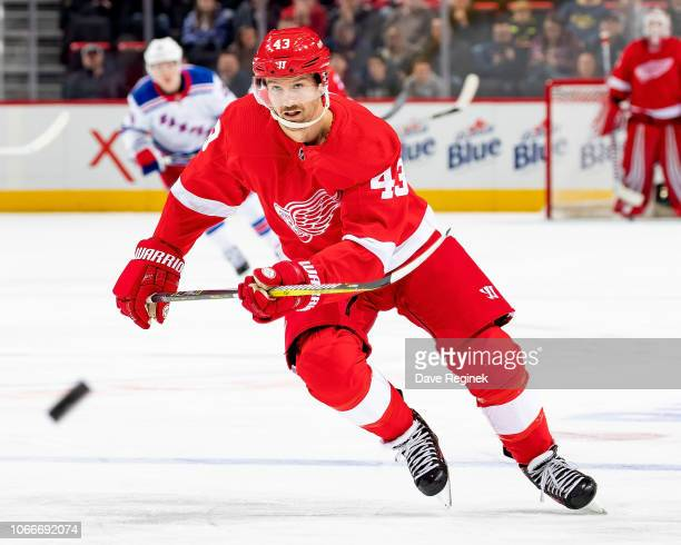 Darren Helm of the Detroit Red Wings shoots the puck against the New York Rangers during an NHL game at Little Caesars Arena on November 9 2018 in...