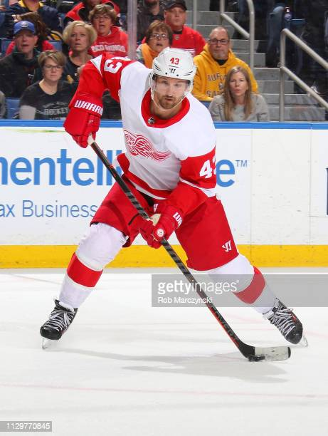 Darren Helm of the Detroit Red Wings shoots the puck against the Buffalo Sabres during an NHL game on February 9 2019 at KeyBank Center in Buffalo...