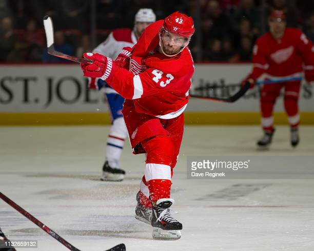 Darren Helm of the Detroit Red Wings shoots the puck against the Montreal Canadiens during an NHL game at Little Caesars Arena on February 26 2019 in...