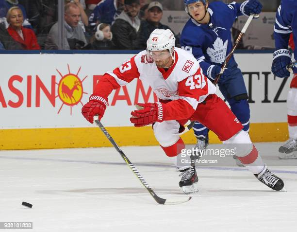 Darren Helm of the Detroit Red Wings skates after a puck against the Toronto Maple Leafs during an NHL game at the Air Canada Centre on March 24 2018...