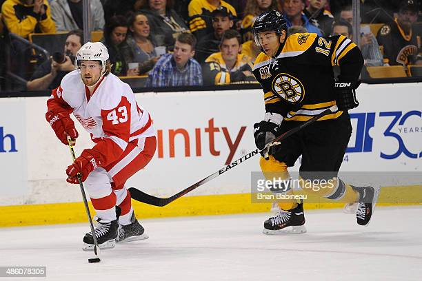 Darren Helm of the Detroit Red Wings skates against Jarome Iginla of the Boston Bruins in Game Two of the First Round of the 2014 Stanley Cup...