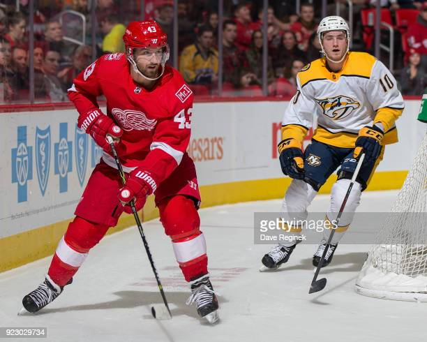 Darren Helm of the Detroit Red Wings skates around the net in front of Colton Sissons of the Nashville Predators during an NHL game at Little Caesars...
