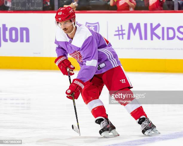Darren Helm of the Detroit Red Wings skates in warm-ups with his custom Hockey Fights Cancer jersey prior to an NHL game against the Arizona Coyotes...