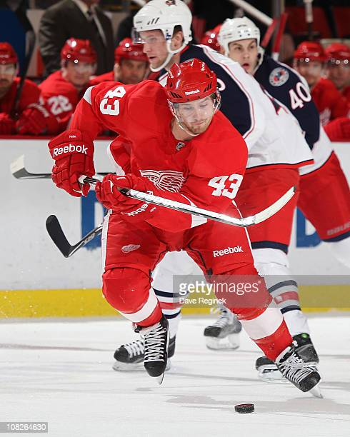 Darren Helm of the Detroit Red Wings skates the puck up ice during an NHL game against the Columbus Blue Jackets at Joe Louis Arena on January 15...