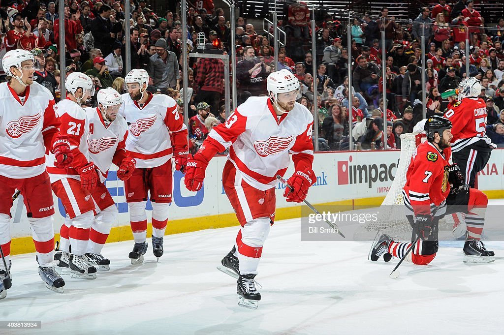 Darren Helm #43 of the Detroit Red Wings skates toward the bench after scoring against the Chicago Blackhawks in the third period during the NHL game at the United Center on February 18, 2015 in Chicago, Illinois.