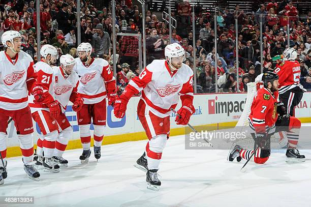 Darren Helm of the Detroit Red Wings skates toward the bench after scoring against the Chicago Blackhawks in the third period during the NHL game at...