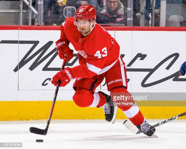 Darren Helm of the Detroit Red Wings skates up ice with the puck against the Montreal Canadiens during an NHL game at Little Caesars Arena on...