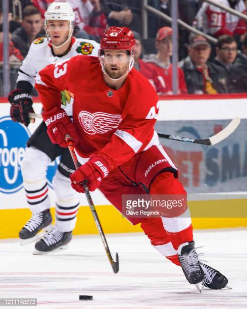 Darren Helm of the Detroit Red Wings skates up ice with the puck against the Chicago Blackhawks during an NHL game at Little Caesars Arena on March 6...
