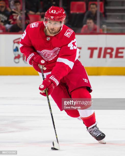 Darren Helm of the Detroit Red Wings skates up ice with the puck against the Tampa Bay Lightning during an NHL game at Little Caesars Arena on...