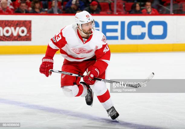 Darren Helm of the Detroit Red Wings slates for position on the ice during an NHL game against the Carolina Hurricanes on March 28 2017 at PNC Arena...