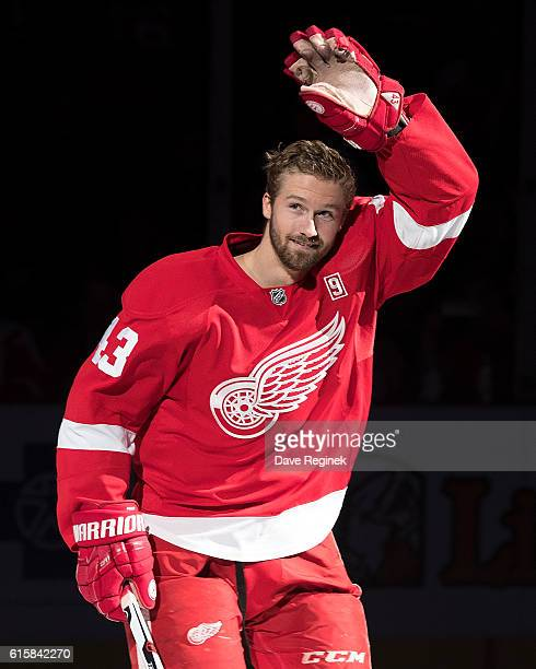 Darren Helm of the Detroit Red Wings takes the ice during opening night ceremonies prior to an NHL game between the Detroit Red Wings and the Ottawa...