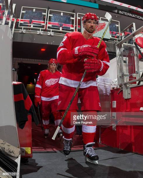 Darren Helm of the Detroit Red Wings walks out to the ice for warm ups before an NHL game against the Washington Capitals at Little Caesars Arena on...