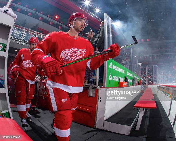 Darren Helm of the Detroit Red Wings walks out to the rink before the start of an NHL game against the New Jersey Devils at Little Caesars Arena on...