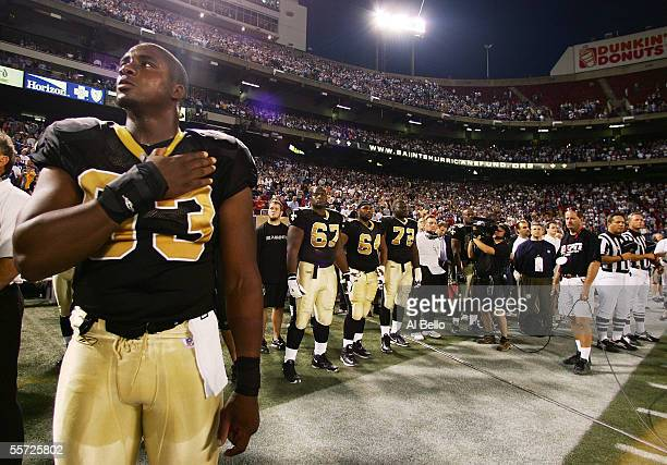 Darren Howard of the New Orleans Saints looks up during the National Anthem before the start of their game against the New York Giants on September...