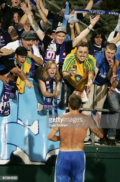 Darren Huckerby of the San Jose Earthquakes celebrates with fans after defeating the New England Revolution 40 in the MLS game at Buck Shaw Stadium...