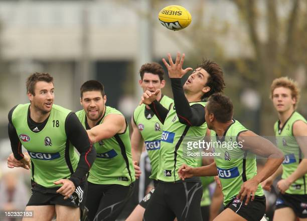 Darren Jolly Chris Dawes Tyson Goldsack and Scott Pendlebury of the Magpies compete for the ball during a Collingwood Magpies AFL training session at...