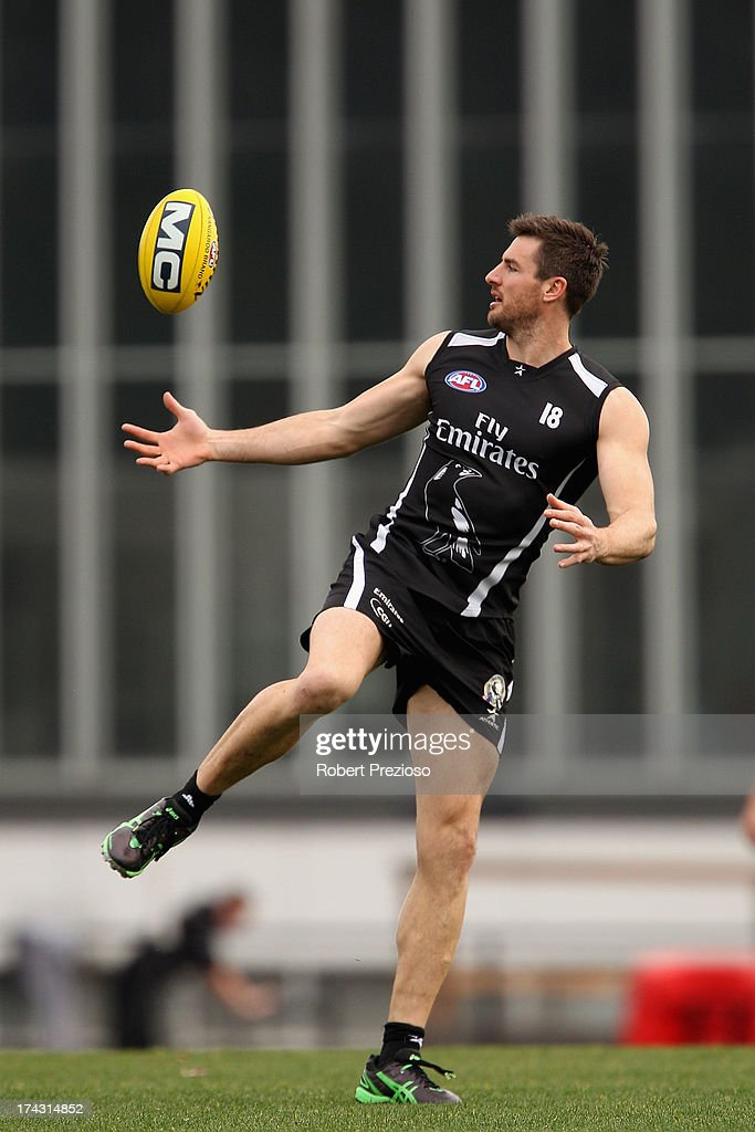 Darren Jolly gathers the ball during a Collingwood Magpies AFL training session at Olympic Park on July 24, 2013 in Melbourne, Australia.