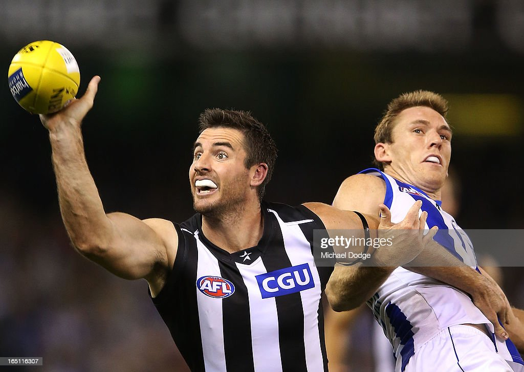 Darren Jolly (L) of the Magpies contests for the ball against Drew Petrie of the Kangaroos during the round one AFL match between the North Melbourne Kangaroos and Collingwood Magpies at Etihad Stadium on March 31, 2013 in Melbourne, Australia.