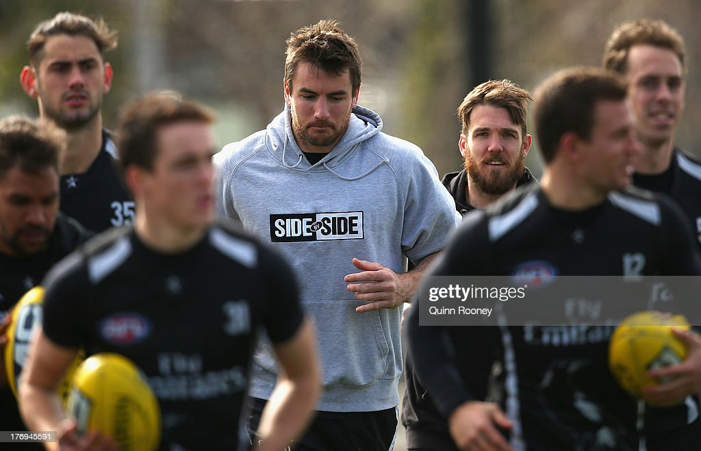 Darren Jolly of the Magpies jogs with his team mates during a Collingwood Magpies AFL training session at Olympic Park on August 20, 2013 in Melbourne, Australia.