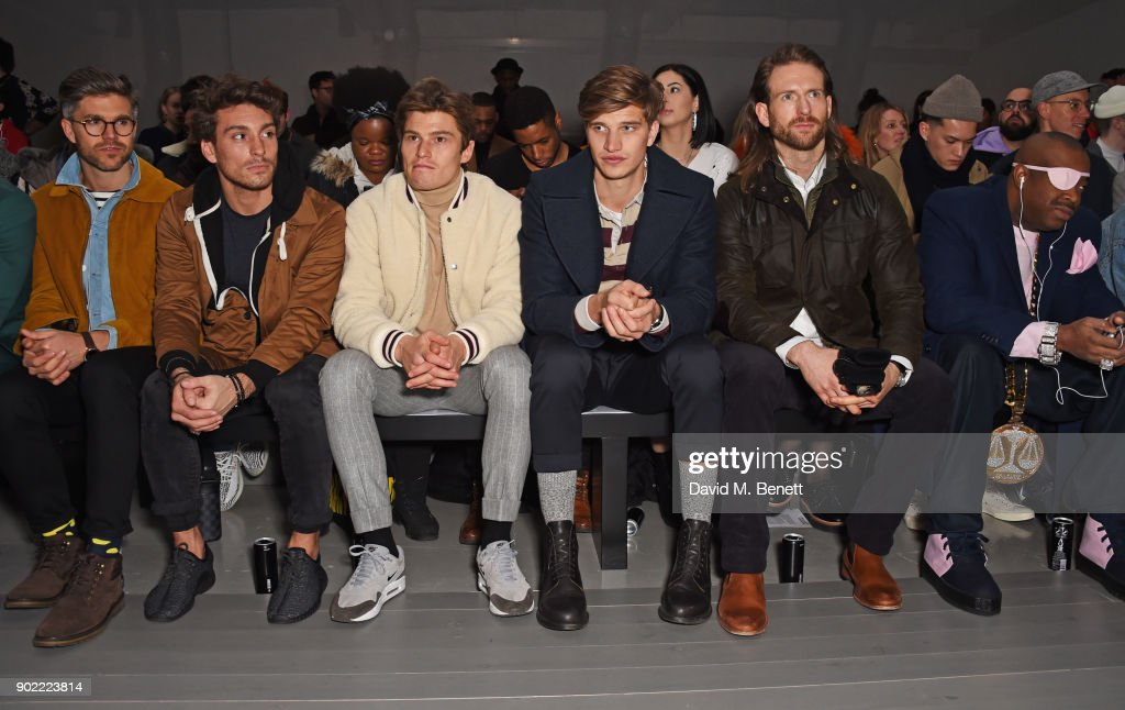 Darren Kennedy, Deano Bugatti, Oliver Cheshire, Toby Huntington-Whiteley, Craig McGinlay and Slick Rick attend the Christopher Raeburn show during London Fashion Week Men's January 2018 at BFC Show Space on January 7, 2018 in London, England.