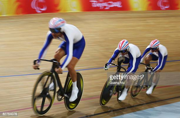 Darren Kenny, Jody Cundy, and Mark Bristow of Great Britain compete in the Men's Team Sprint Track Cycling event at Laoshan Velodrome during day four...