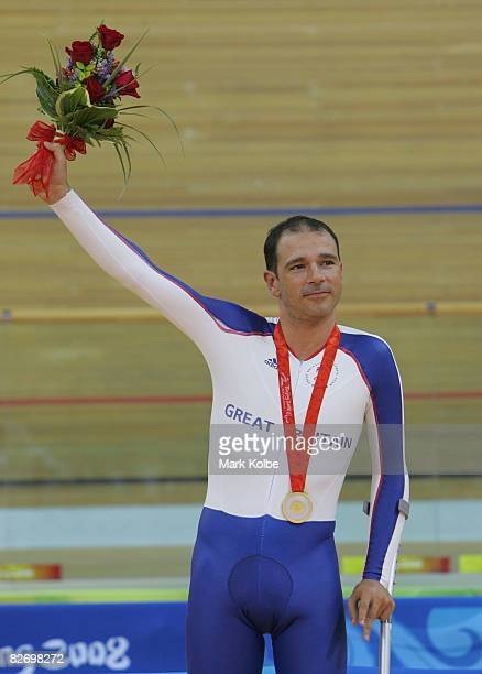 Darren Kenny of Great Britain celebrates on the podium with his gold medal after winning the men's individual pursuit during the Track Cycling event...