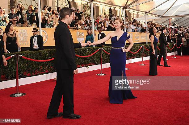 Darren Le Gallo and actress Amy Adams attend 20th Annual Screen Actors Guild Awards at The Shrine Auditorium on January 18 2014 in Los Angeles...